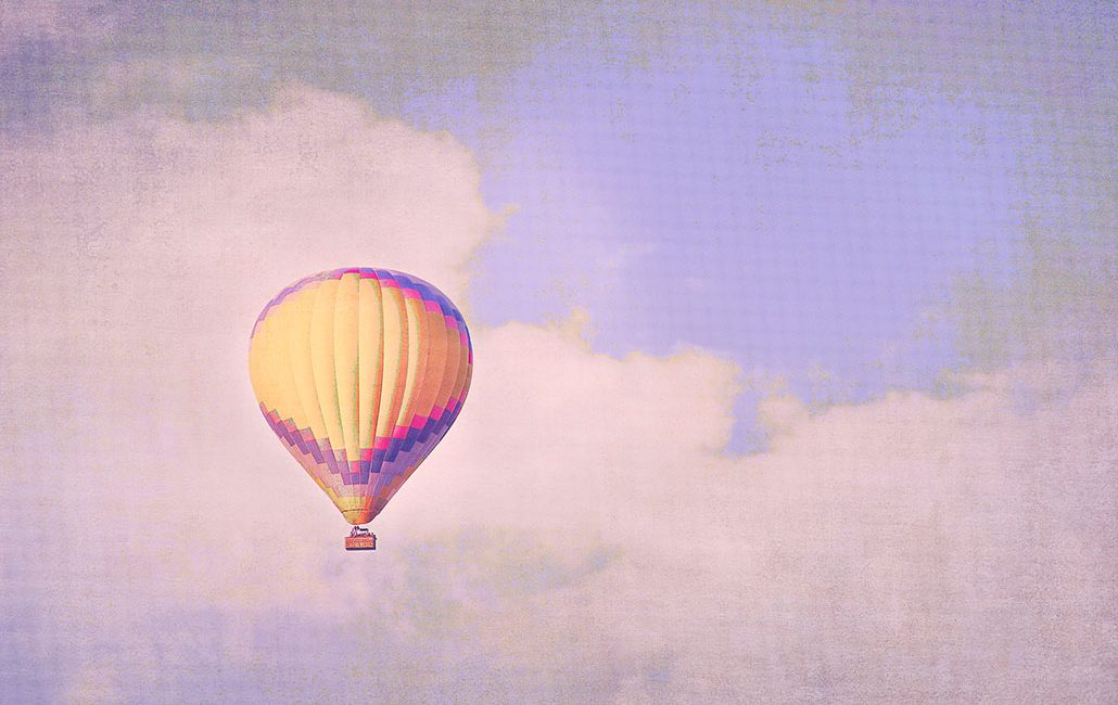 yellow hot air balloon in purple sky photo