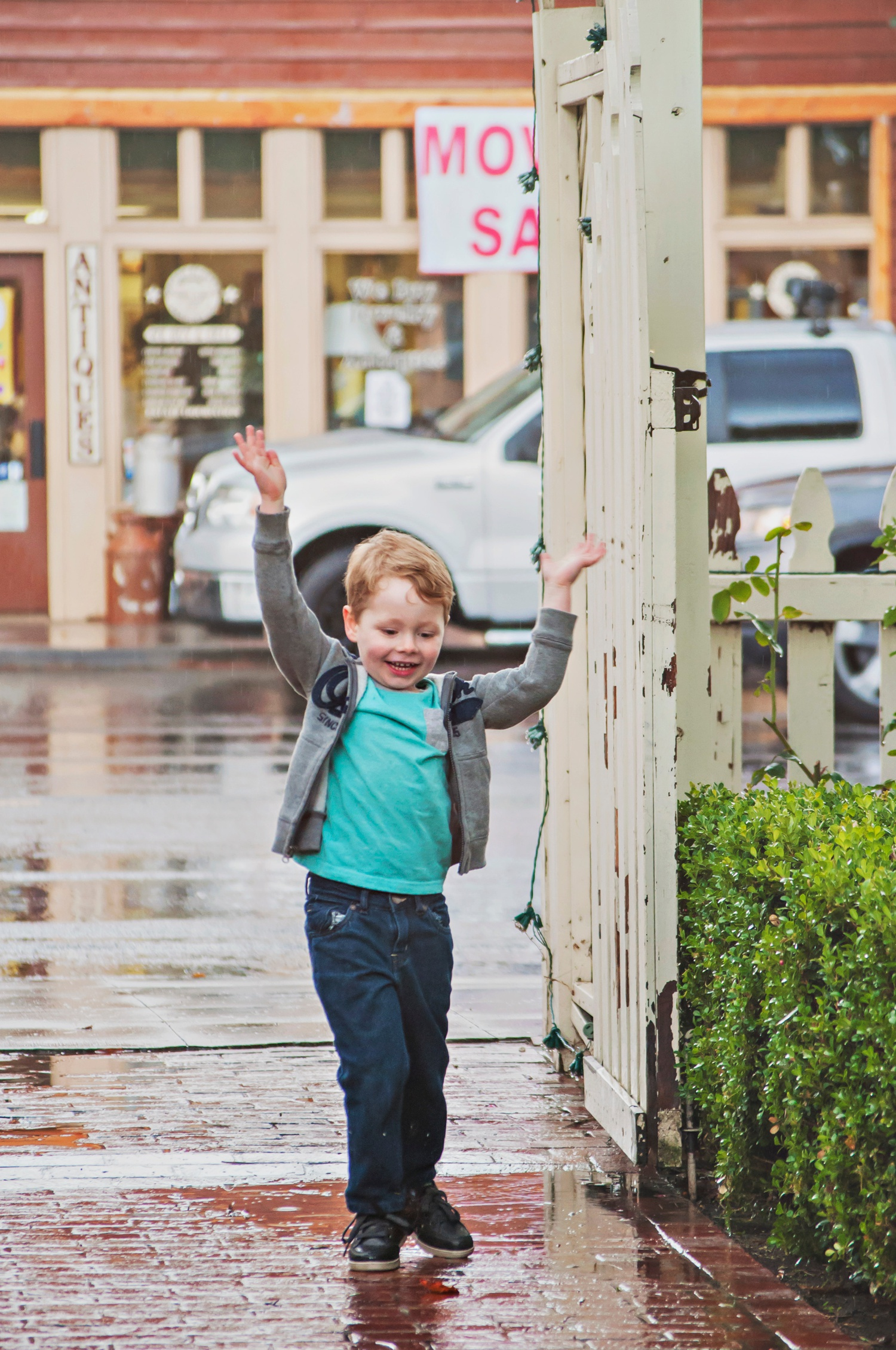 child photography amsw photography boy dancing in rain